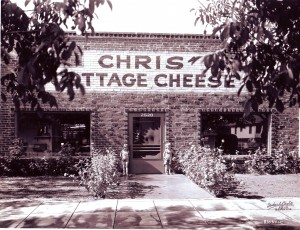Chris Fulster, Jr. and his sister, Joan Fulster, stand in front of Chris' Cottage Cheese in this photograph, which was taken in about 1938.