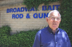 Chris Fulster, Jr. stands near Broadway Bait, Rod and Gun, which he opened more than 40 years ago. Although he continues to work at the business, his son, Chris Fulster III, is the business's owner. / Valley Community Newspapers photo, Lance Armstrong