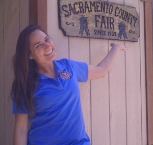 T.J. Plew, the Sacramento County Fair's CEO and manager, shows off a wooden sign celebrating the fair's 1937 founding. / Photo courtesy, Sacramento County Fair
