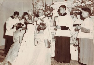 Father Bardon of St. Joseph Church crowns the Riverside Holy Ghost Festa queen during a Mass in the 1950s. / Photo courtesy, PHCS