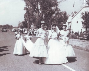 Antoinette D'Alessandro (center), the festa's queen, Rosemary Valine (left) and Marian Lewis are assisted by Susan D'Alessandro and an unidentified girl during the 1956 Holy Ghost Festa parade./ Photo courtesy, PHCS