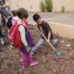 "Students supervise one another as they aerate their ""crop"" of compost. / Valley Community Newspapers photo, Ellen Cochrane"