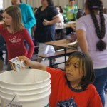 Students empty milk from cartons so the cartons can be recycled into compost. Leftover food is also collected in buckets that will be added to the compost. / Valley Community Newspapers photo, Ellen Cochrane