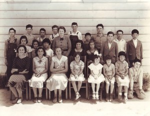 Miss Mildred Fernandes (center) stands with her class in front of Upper Lisbon School in this 1936 photograph. / Photo courtesy, PHCS