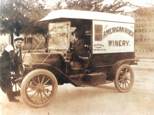 John Silva sits in the driver's seat of an American River Winery delivery vehicle. The name of the winery was later changed to Silva Bros. Winery. / Photo courtesy, PHCS