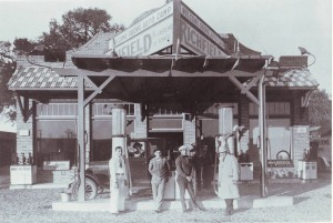 From left to right, Johnny Silvey, manager and part-owner, Mike Ignacio, stepson of owner, attendant John Contente and Fred Herrick, salesman, stand in front of the gas pumps at the Welcome Grove Auto Camp in 1927. / Photo courtesy, PHCS