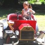 "A young girl rides in one of Funderland's ""Backroads Buggies"" cars. / Valley Community Newspapers photo, Lance Armstrong"
