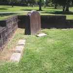 The New Helvetia mass burial site is located near the southeast corner of East Lawn Memorial Park. Shown above is the corner of the site, which features a modern memorial headstone for Joseph H. McKinney, Sacramento County's first sheriff. / Valley Community Newspapers photo, Lance Armstrong