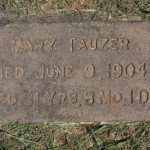 This flat, concrete marker for Mary Tauzer (1873-1904) was one of about 70 such markers that made their way to one of two East Sacramento yards in the 1950s. / Valley Community Newspapers photo, Lance Armstrong