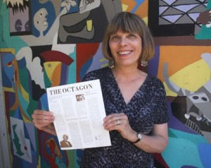 PATRICIA FELS, The Octagon newspaper's advisor, shows off an original copy of the publication's first edition, which was dated Oct. 20, 1977. / Valley Community Newspapers photo, Lance Armstrong