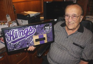 SACRAMENTO KINGS minority owner Joe Benvenuti holds a framed Kings 25th anniversary (1985-2010) art piece, which includes a small portion of Arco Arena's basketball floor. / Valley Community Newspapers photo, Lance Armstrong