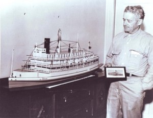 Victor Dias Silva stands alongside his model of the Capital City, which he built in the late 1960s. / Photo courtesy, the Silva family