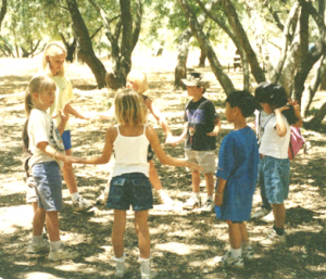 MAKE NEW FRIENDS. Camp Mokitana was a place where children could learn new games, study the natural world and build friendships – as these children in 1999 did. Rotary District 5180's efforts will restore the camp for use by youth organizations in the Sacramento community. / Photo courtesy