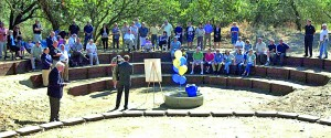 DEDICATION. Members of the community gathered to dedicate the Clarence Copps Amphitheater at Camp Mokitana in River Bend Park. Those attending included Rotarians, representatives from SaveMart Supermarkets and the American River Parkway Foundation and former members of Camp Fire Boys and Girls. Rotary and SaveMart have committed to raise $500,000 for the restoration effort over five years. / Photo courtesy, Rotary District 5180