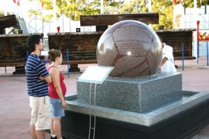 VISITORS to the September 11th Memorial Plaza at Cal Expo observe the plaza's granite sphere, which floats and spins on a thin layer of water. / Valley Community Newspapers photo, Lance Armstrong