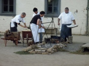 CHEFS PREPARE FOOD on the fire pit at Sutter's Fort during last year's A Taste of History event. / Photo courtesy, Friends of Sutter's Fort