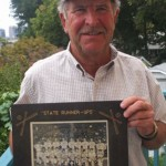 BILL WERRY Werry shows off a photograph of his American Legion Post 61 team that finished second in the state in 1951. / Valley Community Newspapers photo, Lance Armstrong