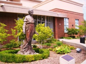 PATRON SAINT OF THE ENVIRONMENT, the namesake saint of St. Francis High School stands at school's entrance. The school is taking a green energy stance, becoming the first Catholic school in the area to adopt solar power to meet its energy needs. / Valley Community Newspapers photo, Susan Laird