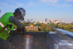 SPARKS FLY as iron worker Dana Sheldon works on the construction of the new Anderson Lucchetti Women's and Children's Center. The level of the downtown skyline in the background reveals that the new midtown Sacramento building has some notable height of its own. / Valley Community Newspapers photo, Lance Armstrong