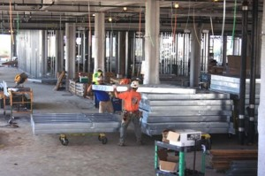 CONSTRUCTION WORKERS handle large sections of steel at the new center, which is scheduled to be completed in June 2013. / Valley Community Newspapers photo, Lance Armstrong