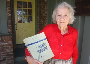 "River Park resident Hinda Westphal holds a first edition copy of her late husband Dr. Frederick Westphal's book, ""Guide to Teaching Woodwinds."" / Valley Community Newspapers photo, Lance Armstrong"