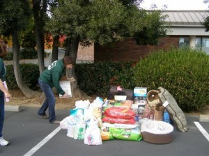 "EVERY BIT HELPS. Donations of bags of pet food – in 5, 10, 20, even 50 pound bags – can help to make a difference in the life of a family in your neighborhood. Grateful families often return months later with a donation of pet food…happy to return the favor for help during a ""rough patch."" / Photo courtesy, Titanic's Pantry"