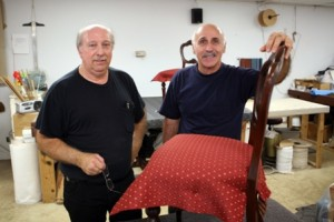 ARTISTS IN THEIR OWN RIGHT. Left to right, Bill Clausen and John Combs bring cherished, heirloom and collectible furniture pieces back to life at B&T Upholstery Repair. From re-covering dining room chairs, to complex projects…these men can do it all. / Valley Community Newspapers photo, Sally King