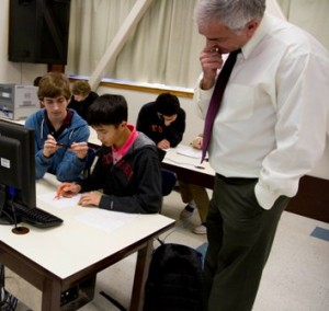 ALGEBRA STUDENTS at Jesuit High School Logan Kemper (left) and Michael Fat (middle) work on a math video while Vito Ferrante (right) looks on. / Photo courtesy, Jesuit High School