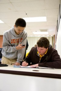 USING NEW TECH. Two algebra students, Joseph Nyguen and Chris Ruggles, left to right, work on a YouTube video. / Photo courtesy, Jesuit High School