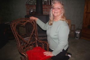 A HEART FOR HISTORY. Arden area resident Penny Hogge-Dayley shows off a 19th century rocking chair. The chair is one of many historical items from her personal collection. / Valley Community Newspapers photo, Lance Armstrong