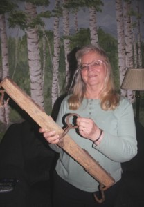 PIONEER ERA ARTIFACT. Penny Hogge-Dayley holds one of her favorite historic artifacts, a doubletree from a 19th century covered wagon. / Valley Community Newspapers photo, Lance Armstrong