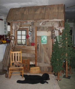 BRINGING THE OUTDOORS IN. This façade of a replica cabin is located inside the Arden area home of Penny Hogge-Dayley. / Valley Community Newspapers photo, Lance Armstrong