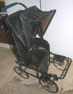 VICTORIAN CHILDHOOD ECHOES. One of Penny Hogge-Dayley's favorite possessions is this child's toy buggy from the 1880s. / Valley Community Newspapers photo, Lance Armstrong