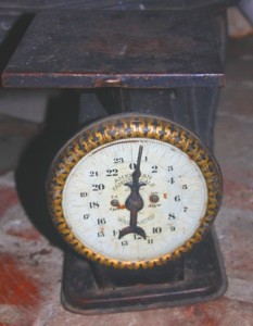 WEIGHTY MATTERS. Penny Hogge-Dayley's collection also includes an antique scale that was used by her great-great grandmother during a time when recipes often called for measurements of weight. / Valley Community Newspapers photo, Lance Armstrong