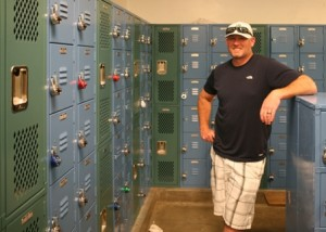 CAL MIDDLE SCHOOL Athletic Director David Carson with the school's new lockers. The boy's locker room in the school gym had not been refurbished for over 50 years. / Valley Community Newspapers photo, Stuart King