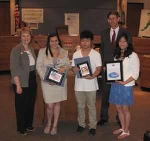 "THEY'RE WINNERS – and they believe in voting. Student winners of the county's first ""I Voted"" sticker contest were recognized by the Sacramento County Board of Supervisors on May 8. Left to right, Jill LaVine, Darian Rosengard, Kevin Thao, Alicia Chan and County Supervisor Don Nottoli. / Photo courtesy, Sacramento County Voter Registration and Elections"