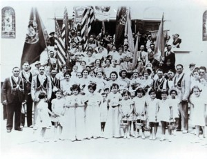 A GRAND FESTA. Parishioners of various ages gather in front of the church on its dedication day in 1913. / Photo courtesy, PHCS