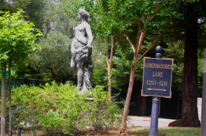A Venus-like statue stands amidst greenery just inside the entrance to the old governor's mansion grounds. / Photo by Lance Armstrong