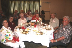 Sitting at the reunion committee table during the 70th reunion of C.K. McClatchy High School's classes of 1942 were, left to right, co-chair Dolores (Silva) Greenslate of the June class, Arleen (Matson) Lotta of the June class, Betty (Lyles) Townsend of the June class, co-chair Peggy (Kneeland) Kinney of the January class, Norm McGee of the June Class of 1940 and Peggy's guest and Norm Greenslate of the June class. / Photo by Lance Armstrong, Valley Community Newspapers