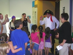 ARRRR…Dressed as Long John Silver, former Councilmember Robbie Waters leads children into the Pocket Tower of Timeless Tales during the library's first anniversary celebration on Aug. 27, 2011. / Photo courtesy, Pocket-Greenhaven Friends of the Library