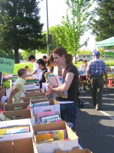 BOOK LOVERS. Guests attend the annual Pocket-Greenhaven Friends of the Library book sale at the Elks lodge parking lot in April 2006. / Photo courtesy, Pocket-Greenhaven Friends of the Library
