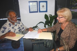 Joan Parks and Clifton Wilson study reports at their office. / Photo by Lance Armstrong