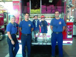 (From left) Ann Kempf, Fire Station #19 engineer; Craig White, Fire Station #19 firefighter/paramedic; Julian Doyle, age 8; Milo Doyle, age 6; and Jason Millgate, Fire Station #19 firefighter.