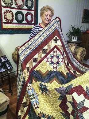 Mary with a large quilt she made / Photo by Sally King