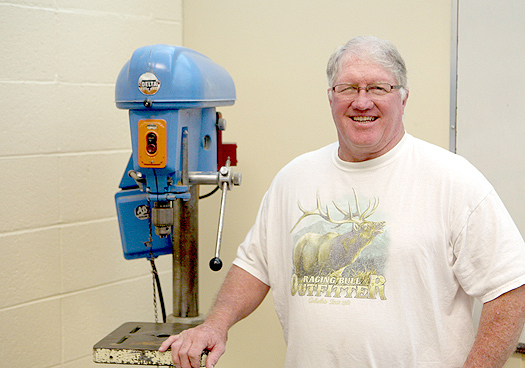 Caption: Bob Priestley, the new woodshop teacher at Sam Brannan Middle School, stands with a drill press. He is excited that the school is bringing back wood shop for the students to take and is requesting the public donate tools and other items to help out the program.  Caption: Students enrolled at Sam Brannan Middle School have the option to take woodshop as an elective this year and will be able to try out the class's jigsaw. // Photos by Sally King