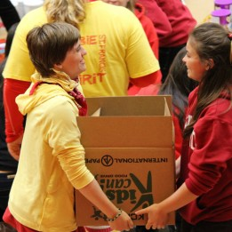 St. Francis High School students in the gym, displaying a portion of the 131,216 good items collected for Foodlink and Elk Grove Food Bank / Photos courtesy of St. Francis High School
