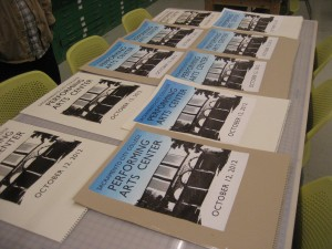 Commemorative posters fresh out of the silk screen printer sit to dry. / Photos by Benn Hodapp
