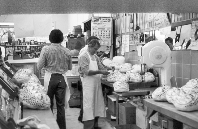 In this photo from 1977, Taylor's Market founder, Ed Schell, and meat counter staff get turkeys ready for pick up. / Courtesy of Taylor's Market
