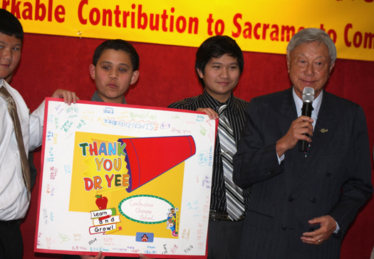 South Land Park resident Dr. Herbert Yee, far right, recently donated a $12,500 check to Sacramento's Confucius Chinese School. To the left of Yee stand three of the school's students, who are holding a sign representing the school's appreciation for this charitable donation. Photo by Lance Armstrong