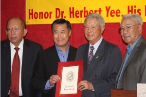 Left to right, Dr. Jong Chen, Senator Leland Yee, Dr. Herbert Yee and Supervisor Jimmie Yee pose for this photograph after Leland Yee presented Herbert Yee with a state senate proclamation. Photo by Lance Armstrong